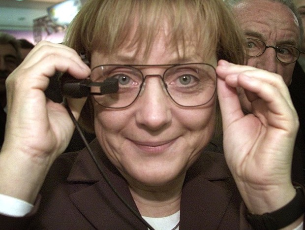 Angela Merkel, leader of Germany's opposition Christian DemocraticUnion party (CDU) tries out a pair of glasses with a mounted miniaturescreen during her visit to the computer fair CeBIT in Hanover March 19,2002. The world's largest technology and communications fair openedlast week in the northern German city of Hanover amid industry hopesthat it could spark a recovery in a sector hard hit by an economicslump. REUTERS/Christian CharisiusCHA/WR/AA